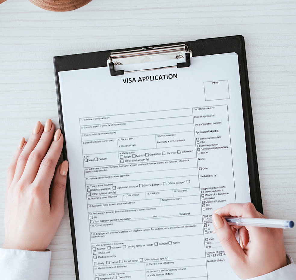 photo of a woman completing a visa application for entry to Canada